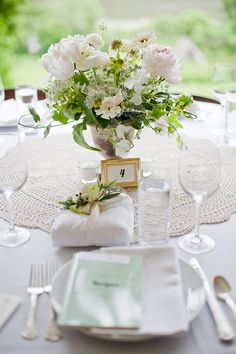 Love the idea of white everything for an event, especially a wedding.  The green looks so striking.