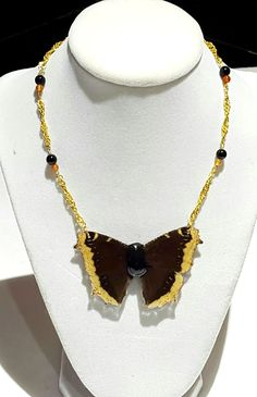 real butterfly wing necklace. real mourning cloak butterfly with ceramic body. wings are coated in jewelry grade resin. 24k gold filled chain. purchases help save rainforest and butterfly populations. on sale on etsy www.etsy.com/shop/fromearthjewelry