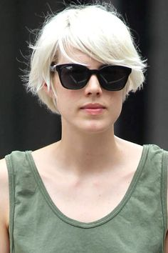 I like the way Agyness Deyn's fringe sits on top of her sunny's with a side sweep.