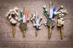 DIY boutonnieres with glittered feathers and baby's breath.
