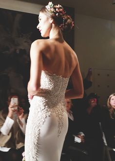 A lacy strapless #weddingdress from @reemacra | Brides.com