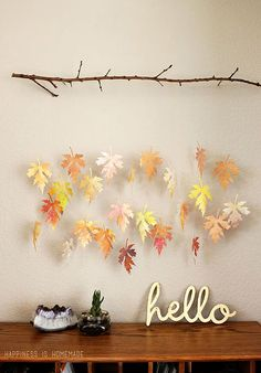 DIY Fall Leaf Mobile: For this rustic wall decor, use fallen leaves that you find outdoors or watercolor paper leaves that you can make yourself. Click through to find more DIY fall leaf crafts for kids and adults.