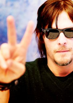 "PEACE / HE DOES HAVE MORE THAN 1 FINGER / A RARE PIC OF NORMAN WITHOUT HIS ""MIDDLE"" FINGER RAISED"