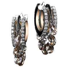 Close-fitting oval shape diamond hoop earrings, with 14 champagne diamond briolettes of 3.2 TCW, sit snugly on the ear, by Alexandra Mor