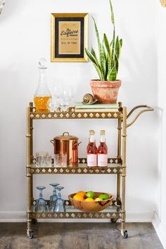 Bar carts serve as stylish yet hardworking hubs for entertaining. Learn how to style your beverage station with these beautiful bar cart ideas. #barcart #barcartstyling #barcartideas #barcartdecor #bhg Diy Bar Cart, Bar Cart Decor, Brass Bar Cart, Outdoor Bar Cart, Drink Cart, Vintage Bar Carts, Elegant Christmas, Wooden Bar, Bars For Home