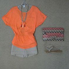 Trina Turk Maurine orange top with low v back, Bcbg Symon shorts in khaki, Bcbg poppy combo tassel necklace, multi woven straw clutch, and Pella Moda Ellie braided sandal.