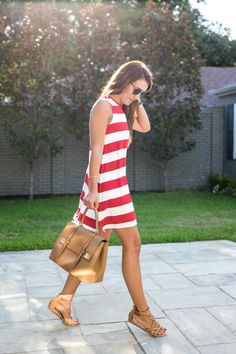 Amy Havins wears a red and white striped dress from Charming Charlie.