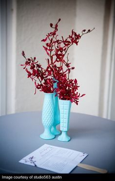 Aqua Vase with red orchids?