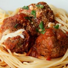 "Nothing says ""home cooking"" like a good plate of meatballs. Tiny balls of fresh mozzarella are the ""surprise inside"" this hearty dish, which uses the slow cooker as a prep shortcut."