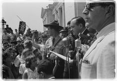 "Photograph shows a group of people, one holding a Confederate flag, surrounding speakers and National Guard, protesting the admission of the ""Little Rock Nine"" to Central High School. Little Rock Nine, American Alphabet, Stonewall Riots, Surround Speakers, Fantastic Voyage, Southern Heritage, Confederate Flag, National Guard, Magnum Photos"