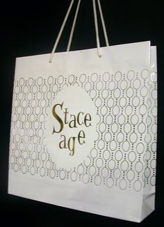 Gold foil and glossy white shopping bag designed for Staceage.