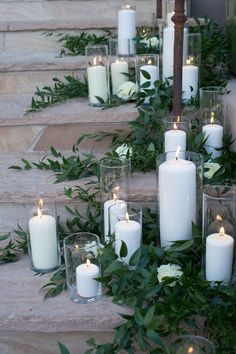 pillar candles and greenery on stairs Wedding Stairs, Wedding Pillars, Wedding Ceremony Candles, Simple Weddings, Romantic Weddings, Perfect Wedding, Dream Wedding, Simple Wedding Centerpieces, Centerpiece Flowers