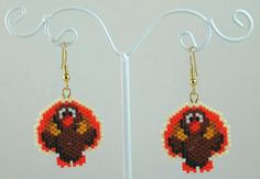 The item up for sale is a pair of beaded earrings. The design features an adorable turkey.  The main portion of the earring is constructed by
