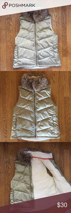 EUC Gap Puffer Vest - Medium EUC Gap Puffer Vest - medium. Gold color with faux fur around the neck. Fleece lined. So warm & stylish. Retail $98 GAP Jackets & Coats Vests
