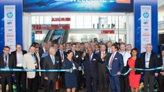 FESPA President Lascelle Barrow cuts the ribbon, with CEO Neil Felton and Divisional Director Roz McGuinness