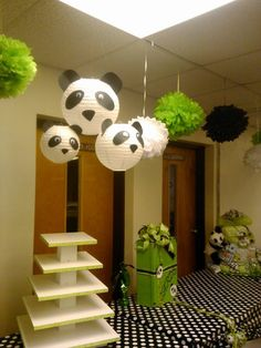 Panda lanterns, cake stand, card box, and diaper cake for panda baby shower