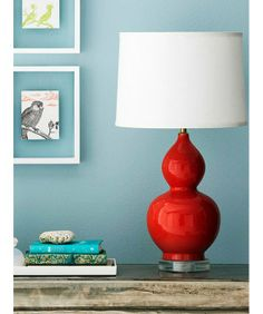 Accent pieces are easier to adjust to, cost less than furniture and are less of a permanent commitment than paint. Get a lamp in a bright color—be it the post or the shade—and don't worry about matching it with anything else.