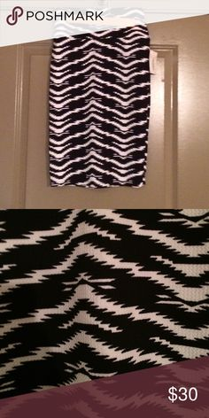 NWT LuLaRoe Wavy Zebra Print Cassie Skirt Size XS Up for sale is the amazing Cassie skirt from LuLaRoe! This skirt is super comfortable and stretchy. Dress it up for a night out with the girls or wear casually with a t-shirt. Yoga waistband. Please let me know if you have questions! LuLaRoe Skirts Pencil