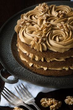 My recipe for a classic Coffee & Walnut Cake. Three layers of delicious coffee s… My recipe for a classic Coffee & Walnut Cake. Three layers of delicious coffee sponge packed full of chopped walnuts and topped with smooth coffee buttercream. Coffee Recipes, My Recipes, Sweet Recipes, Baking Recipes, Cake Recipes, Dessert Recipes, Coffee Flavored Cake Recipe, Coffee Cake Decoration, Coffee Buttercream