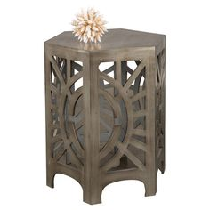 Wood side table in gray with a hexagonal silhouette and fretwork detail.  Product: Side tableConstruction Material: ...
