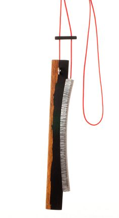 JANET HINCHLIFFE McCUTCHEON-UK Necklace: Linear Connection I  Silver, textile cord, African Blackwood  Photo: Joel Degen