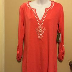 Eliana Tunic ( Lily Pulitzer) Is island coral tunic with exclusive embellishments and is 100% cotton Lilly Pulitzer Tops Tunics