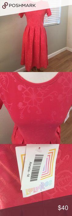 LuLaRoe Medium Amelia. Pink New with tags LuLaRoe Medium Amelia. Pink coral color with embossed flowers LuLaRoe Dresses
