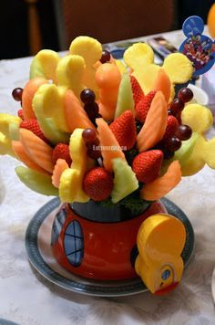 Disney themed fruit arrangement my coworkers bf sent her one for early vday she's so lucky