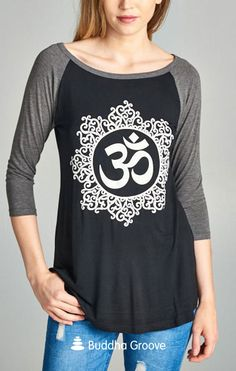 Om is the sound of the universe, a cosmic vibration, and our connection to the divine. This beautiful and moving symbol features prominently on this comfy raglan style tee. Made from the softest blend of rayon and cotton, t-shirt is designed to have a relaxed fit.