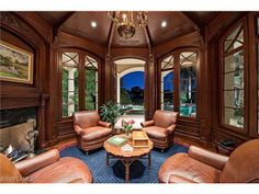Estates at Bay Colony Golf Club | Wood paneled home study with fireplace