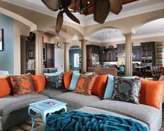 I love this color pallet for the family room- orange, turquoise, brown, gray