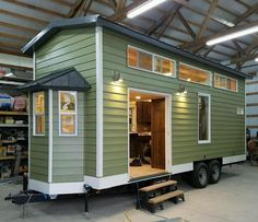 The Cado: a 300 sq ft home with a cozy pine interior from Thimble Homes.
