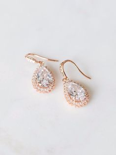 Catherine Earrings—fit for royalty. See more here: https://www.davieandchiyo.com/collections/bridal-earrings/products/catherine-earrings