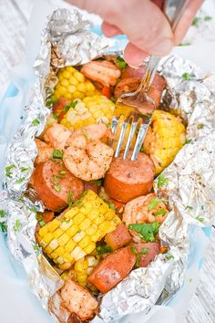 All the flavors of a shrimp boil, but done in a much simpler way! Easy to prep ahead of time making them perfect for weeknight meals & camping trips! Cajun Recipes, Sausage Recipes, Seafood Recipes, Sausage Meals, Lunch Recipes, Corn In The Oven, Easy Corn Fritters, Grilled Romaine Salad, Shrimp Boil Foil