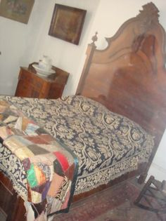 Whaley House Ghost Photograph - This was taken at the Whaley House in San Diego. Is that a ghost against the headboard? What do you think?
