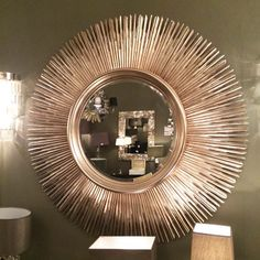 This sun style mirror offers a large bold design that would blend effortlessly into almost any room in your home. The mirror can instantly add a glamorous elegant look to any room in your home. The stunning gold finish of the mirror adds warmth to your home as well as