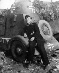A German soldier at the captured armored car BA-20.