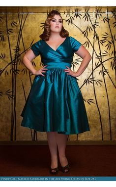 Looks more like teal. Pinup Couture- Ava Swing Dress in Turquoise Taffeta - Plus Size | Pinup Girl Clothing