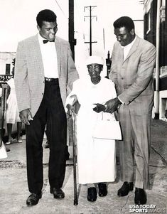 Muhammad Ali and his younger brother Rahman Ali, with their grandmother