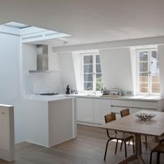 Mews House is a minimalist home located in Notting Hill, London, designed by MRJ Rundell + Associates.