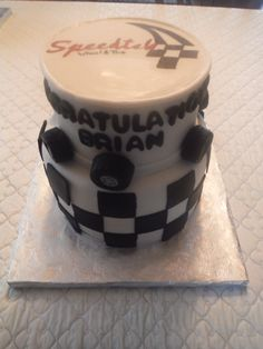 A cake for the grand opening of a new tire shop. Logo on top is hand-painted.