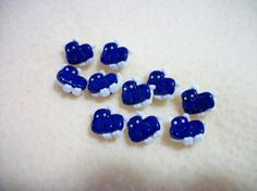 These cute Hippos buttons are ready to enhance your knitting, crocheting, sewing, quilting or craft project.   • Measure approximately 15 mm  • Button is a snap-together with a self shank  • COLOR: Assorted shades, as shown in the picture. • 5 pieces