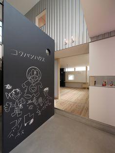 Blackboard walls (achieved through paint finishes). P.S. Cute Doraemon!