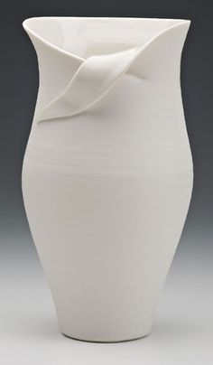Cut and curled rim vase ... love the elegant simplicity of this piece.