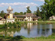 La maison de la reine and the Tour de Marlborough (left) in le hameau, at the Petit Trianon, park of Versailles