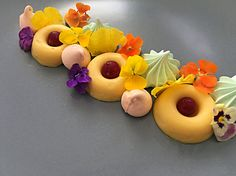 Passion fruit cream with cranberries and meringue and flowers