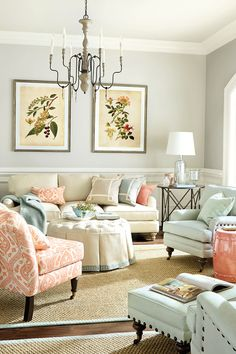 Living room with coral color palette from How To Decorate.