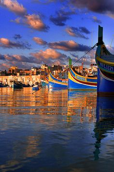 colorful boats at sunset