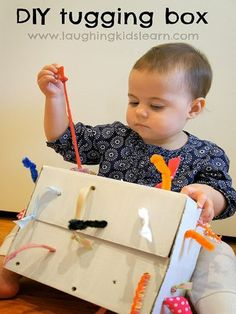 34 Creative Play Activities for Babies Under 1 Year- I'm totally making this tugging box for my babygirl! She's obsessed with strings and ribbons!