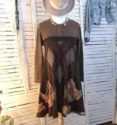 Funky Boho Upcycled Sweater Tunic in browns. A flattering above the bust cut and plenty of volume in the flowing hem. Caramel Brown in the bodice top, dark brown, gray and wine argyle in the hem. I added pockets from Vintage laces and florals. Also decorated with vintage laces and floral